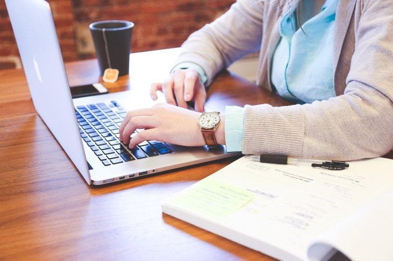 student using laptop for studies