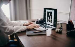 Woman editing photos on Macbook laptop