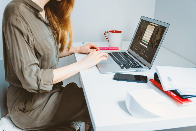Woman using laptop on study desk
